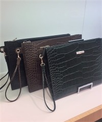 Longchamp clutch bags with wrist straps