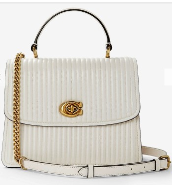 New season fashion bags for Spring and Summer 2019.  Single colour bags including the quilted top handle bag in chalk white from Coach.