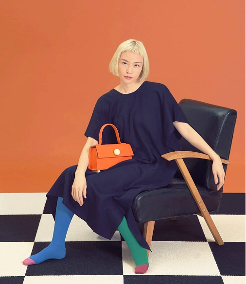 SS19 fashion bags instore and online now including an orange mini trapezoid satchel bag from Matter Matters