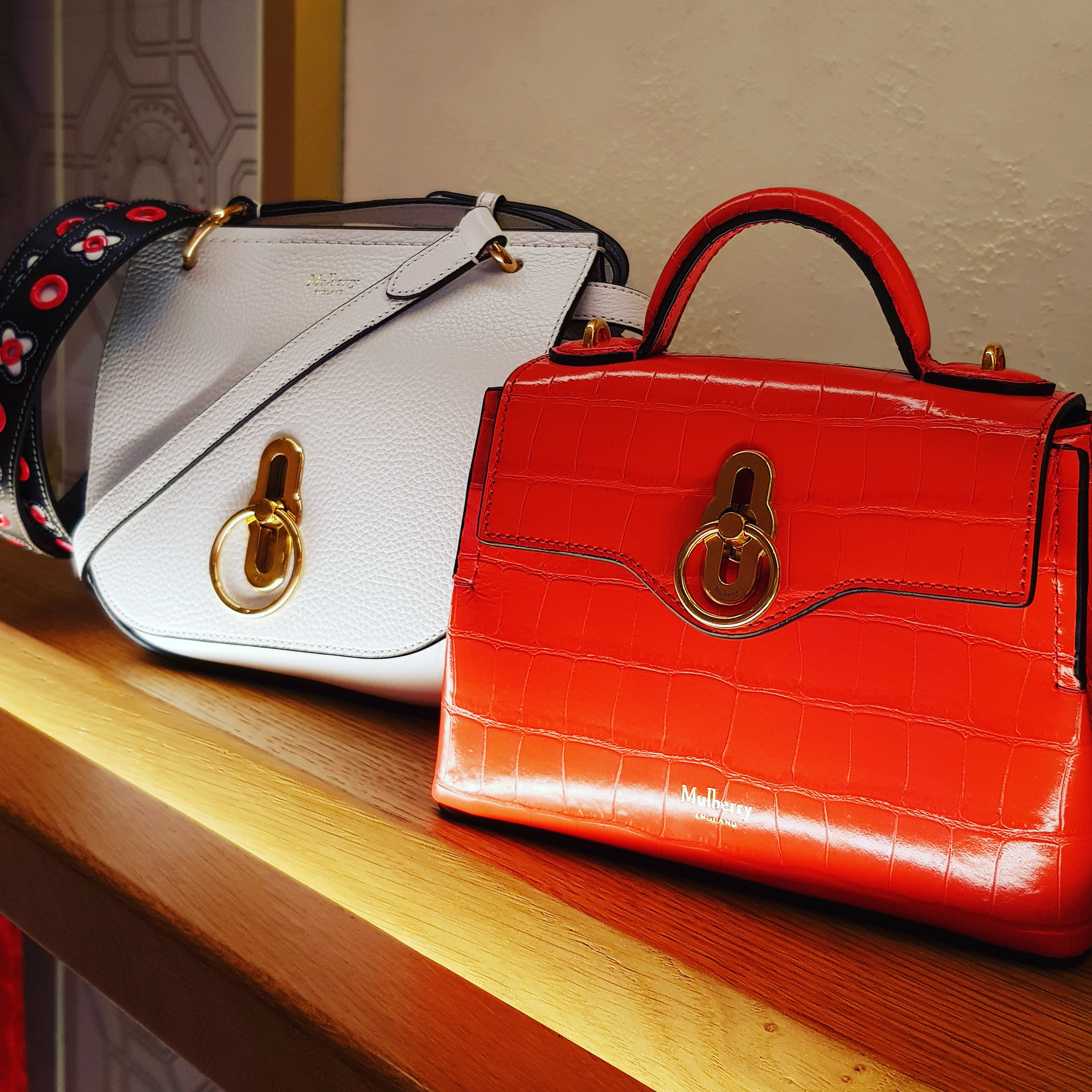 New season fashion bags for Spring and Summer 2019 from Mulberry including the hibiscus red top handle bag and white crossbody bag.