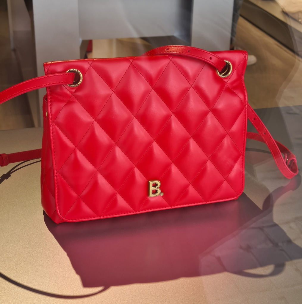 Discount designer bags for AW'20 including a red quilted shoulder bag from Balenciaga.